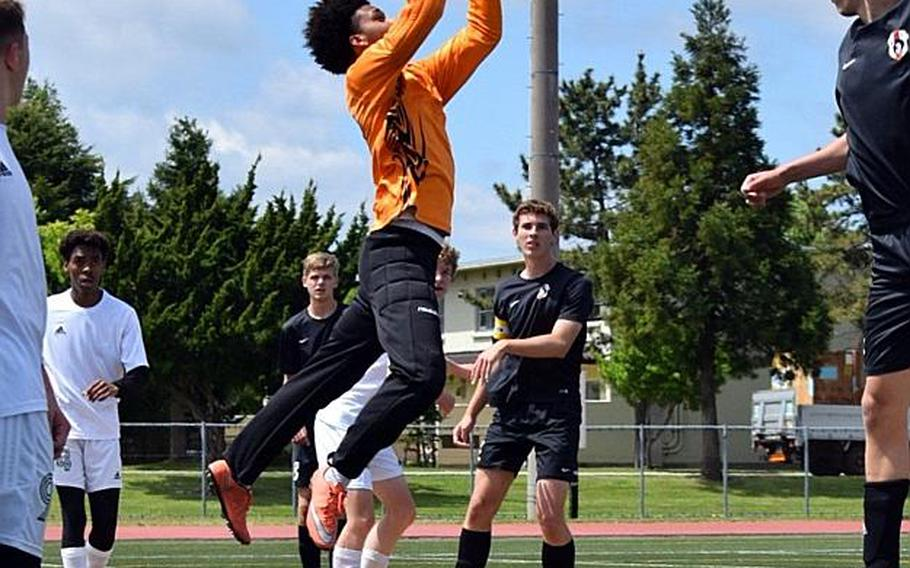 Robert D. Edgren goalkeeper Tariq Lewis skies to stop a shot against Zama during Wednesday's playoff match in the Far East Boys Division II Soccer Tournament, won by the Trojans 6-0.  COKO MAGBY/SPECIAL TO STRIPES