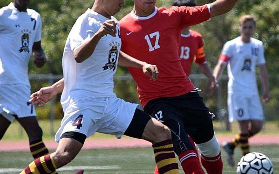 Matthew C. Perry's Kai Lange and Okinawa Christian's Kai Koreen battle for the ball during Wednesday's playoff match in the Far East Boys Division II Soccer Tournament, won by the Crusaders 1-0. It dethroned the five-time defending champion Samurai.  COKO MAGBY/SPECIAL TO STRIPES
