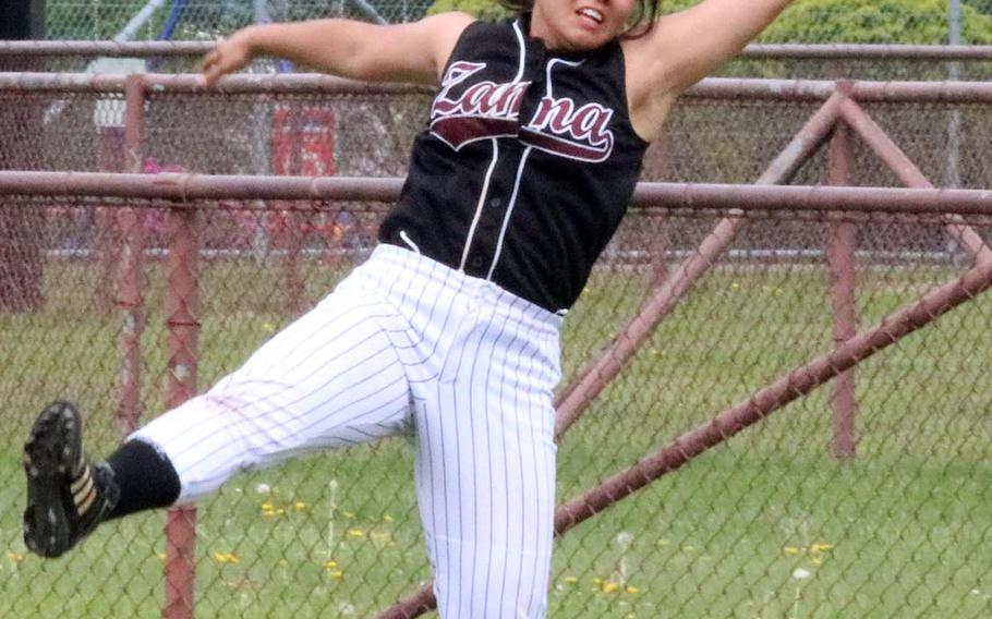 Zama American outfielder Haruki Fuentes lunges to catch a fly ball against Matthew C. Perry during Friday's pool-play game in the DODEA Japan softball tournament. The Trojans won 10-8.