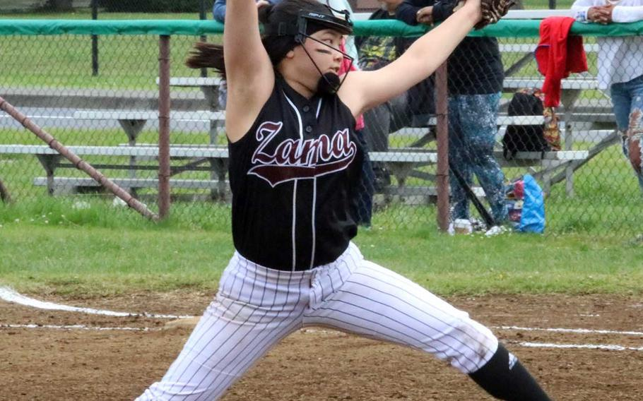 Zama American's Aika Davis delivers against Matthew C. Perry during Friday's pool-play game in the DODEA Japan softball tournament. The Trojans won 10-8.