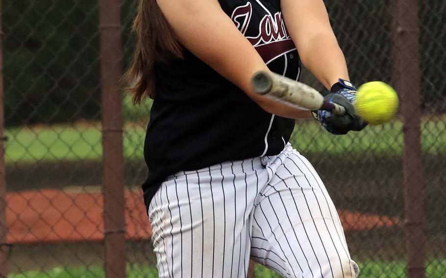 Zama American's Jessica Atkinson takes her cuts against Nile C. Kinnick during Friday's single-elimination playoff game in the DODEA Japan softball tournament. The Trojans won 16-3.