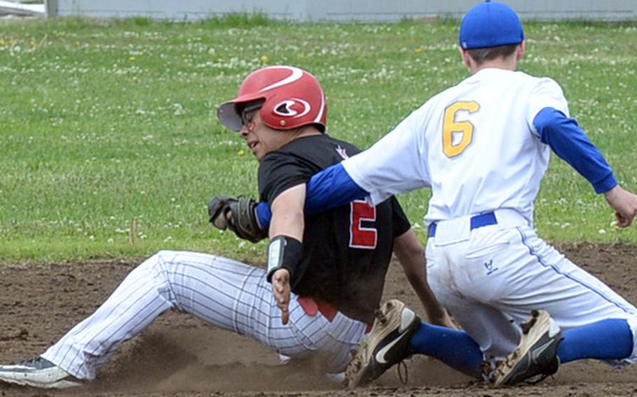Nile C. Kinnick pinch-runner Julian Alvarez slides into the tag of Yokota second baseman Jeff Mullarkey during Friday's round-robin game in the DODEA Japan baseball tournament. The Panthers edged the Red Devils 3-2.