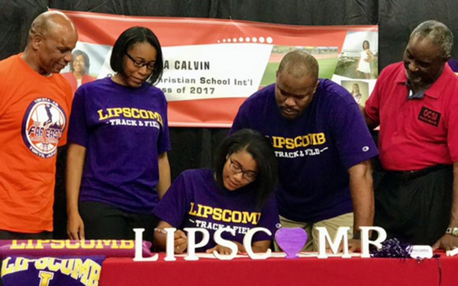 With parents and coaches looking on, Okinawa Christian senior sprinter-high jumper Tia Calvin signs a national letter of intent, committing to NCAA Division I Lipscomb University of Nashville, Tenn., in the Atlantic Sun Conference.
