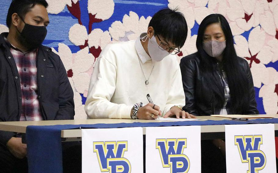 Matthew C. Perry senior Joseph Andres signs an offer to play volleyball at William Penn University in Iowa.