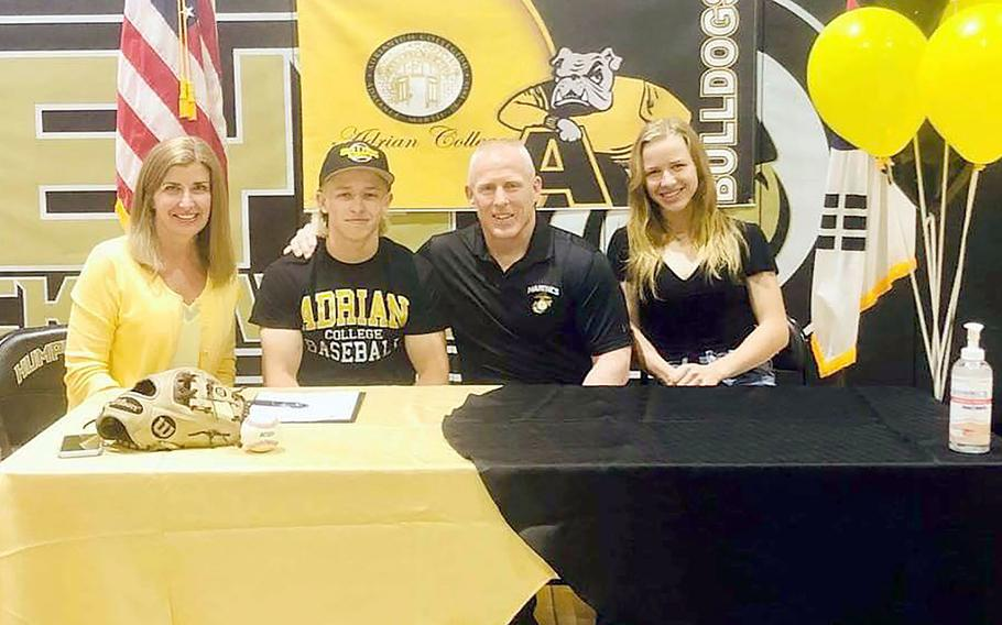 Humphreys senior Max Weidley, second from left, celebrates with his family his signing to play baseball for Division III Adrian College (Mich.) next year. At left is Jill Weidley, at right is Marine Corps Maj. Gen. Thomas Weidley and Max's twin sister Zoe.
