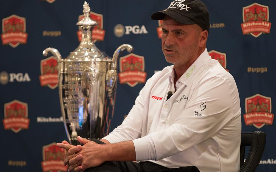 Rocco Mediate, defending champion of the Senior PGA Championship tournament, sits next to his trophy during a press conference for this year's Senior PGA tournament, to be held at the Trump National Golf Club in Potomac Falls, Virginia. Mediate, along with PGA of America president Paul Levy and Eric Trump were spoke to members of the press from the Trump International Hotel in Washington on Thursday, March 9, 2017.
