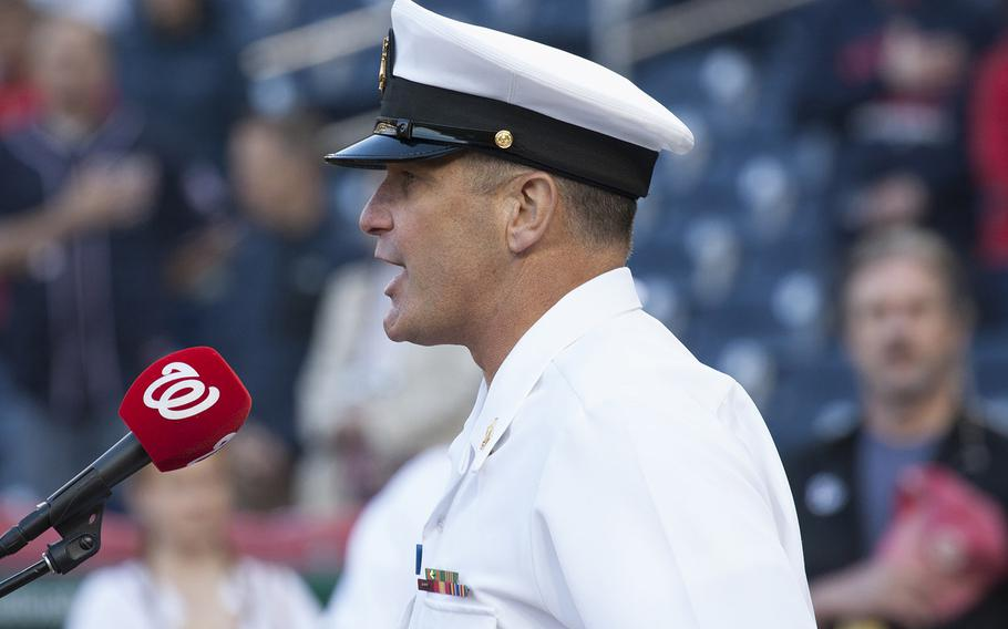 Musician 1stClass Kenny Ray Horton of the Navy Band sings the national anthem on U.S. Navy Day at Nationals Park in Washington, D.C., May 3, 2017.