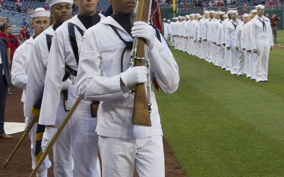 The U.S. Navy Ceremonial Guard marches onto the field on U.S. Navy Day at Nationals Park in Washington, D.C., May 3, 2017.