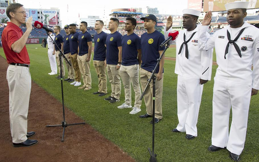 New and re-enlisting sailors take the Oath of Enlistment from Acting Secretary of the Navy Sean Stackley on U.S. Navy Day at Nationals Park in Washington, D.C., May 3, 2017.
