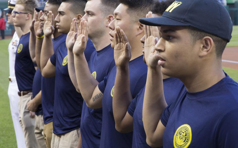 New sailors take the Oath of Enlistment on U.S. Navy Day at Nationals Park in Washington, D.C., May 3, 2017.