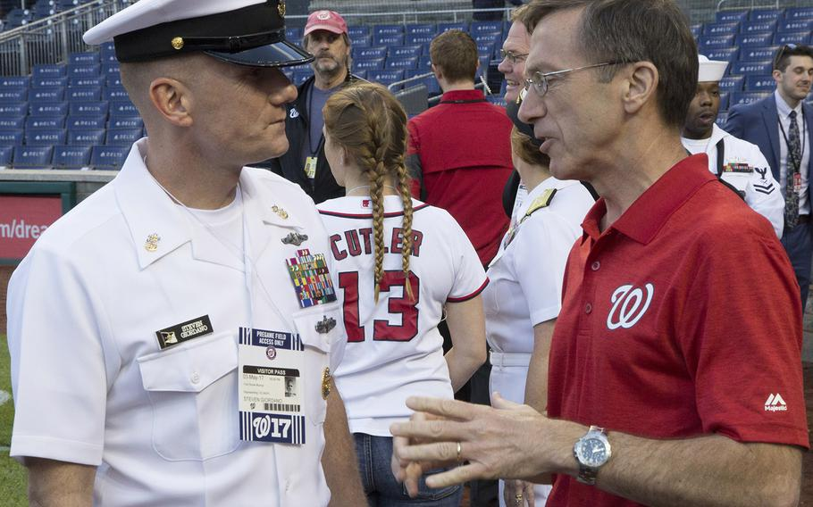 Master Chief Petty Officer of the Navy Steven Giordano talks with Acting Secretary of the Navy Sean Stackley on U.S. Navy Day at Nationals Park in Washington, D.C., May 3, 2017.
