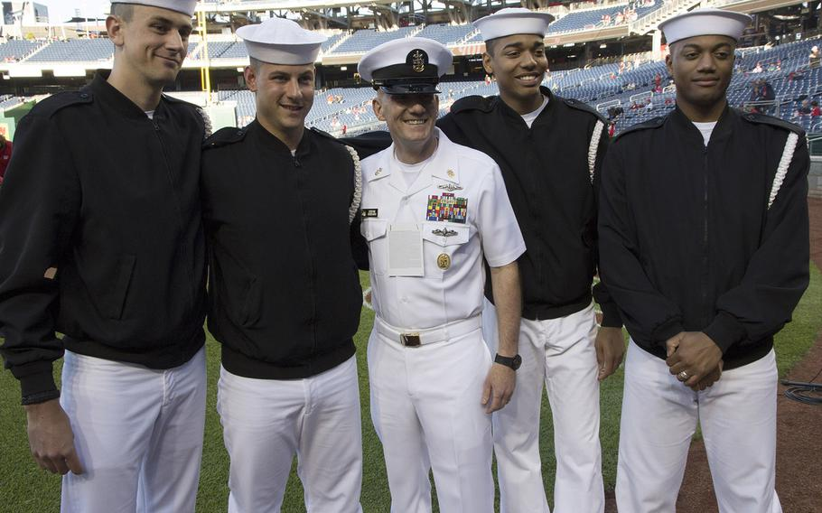 Sailors pose for a photo with Master Chief Petty Officer of the Navy Steven Giordano on U.S. Navy Day at Nationals Park in Washington, D.C., May 3, 2017.