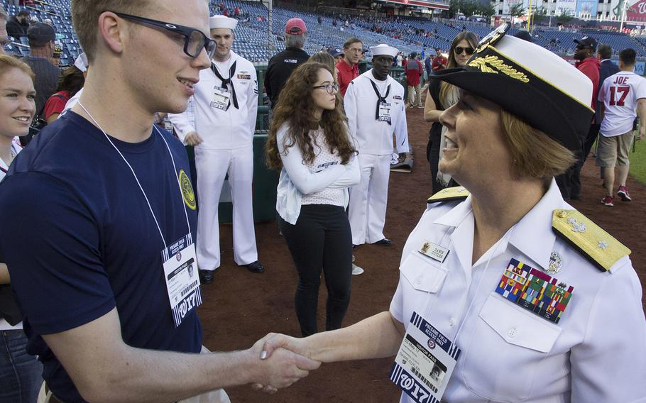 Rear Adm. Dawn E. Cutler, U.S. Navy Chief of Information, talks with soon-to-be sailor Jerico Johanson on U.S. Navy Day at Nationals Park in Washington, D.C., May 3, 2017.
