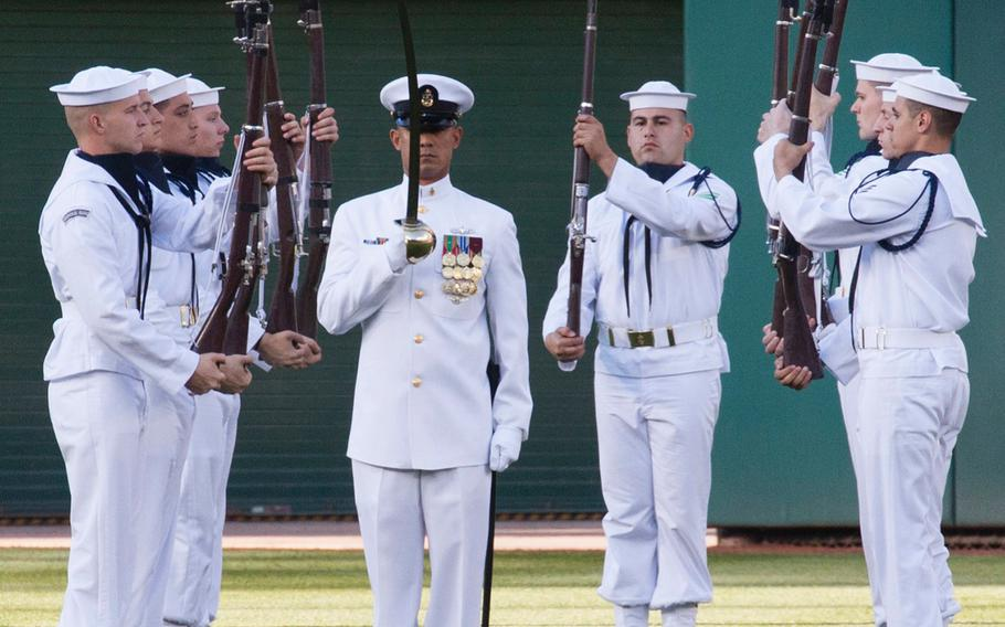 The U.S. Navy Ceremonial Guard drill team performs on U.S. Navy Day at Nationals Park in Washington, D.C., May 3, 2017.
