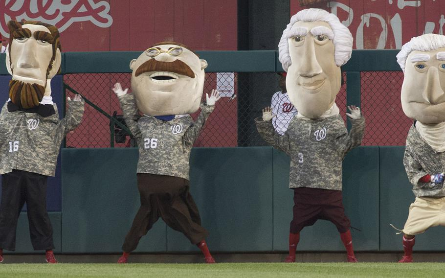 The Washington Nationals' president mascots, clad in appropriate uniforms for the occasion, on U.S. Army Day at Nationals Park in Washington, D.C., June 12, 2017.