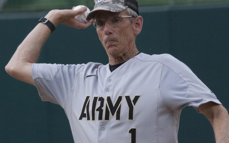 Acting Secretary of the Army Robert M. Speer throws out the ceremonial first pitch on U.S. Army Day at Nationals Park in Washington, D.C., June 12, 2017.