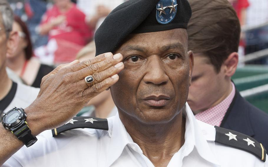 Maj. Gen. Timothy M. McKeithen, Deputy Director of the Army National Guard, salutes during the national anthem on U.S. Army Day at Nationals Park in Washington, D.C., June 12, 2017.