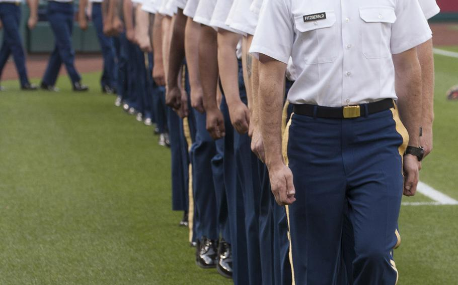 Soldiers from the 1st and the 4th Battalions of the 3rd Infantry Regiment walk onto the field on U.S. Army Day at Nationals Park in Washington, D.C., June 12, 2017.