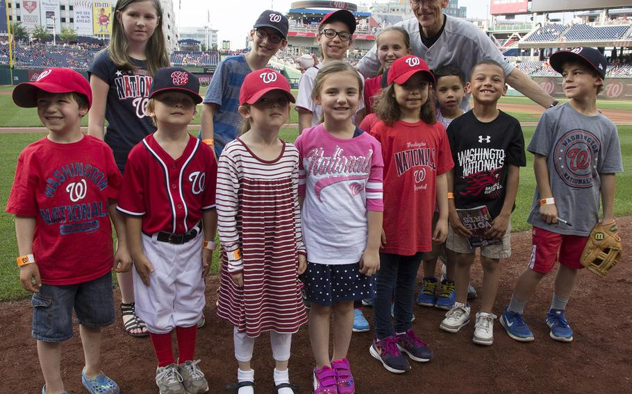 Acting Secretary of the Army Robert M. Speer poses for a photo with soldiers' children on U.S. Army Day at Nationals Park in Washington, D.C., June 12, 2017.