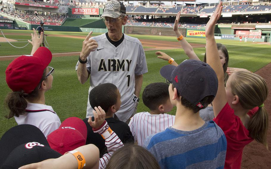 Acting Secretary of the Army Robert M. Speer talks with soldiers' children on U.S. Army Day at Nationals Park in Washington, D.C., June 12, 2017.
