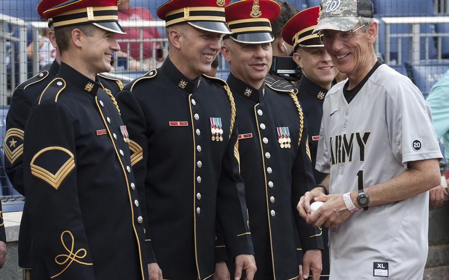 Acting Secretary of the Army Robert M. Speer talks with members of the Army Chorus of The United States Army Band on U.S. Army Day at Nationals Park in Washington, D.C., June 12, 2017.