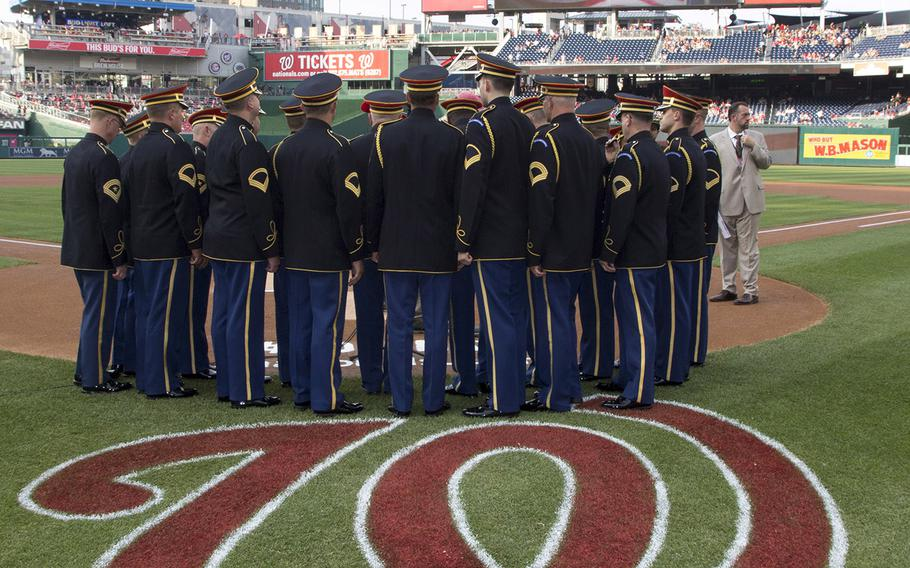 The Army Chorus of The United States Army Band prepares to perform the National Anthem on U.S. Army Day at Nationals Park in Washington, D.C., June 12, 2017.