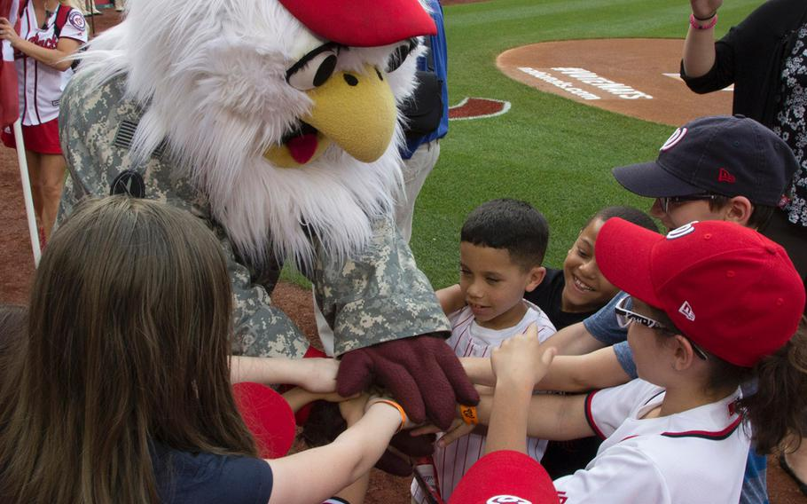 Washington Nationals mascot Screech talks with soldiers' children on U.S. Army Day at Nationals Park in Washington, D.C., June 12, 2017.