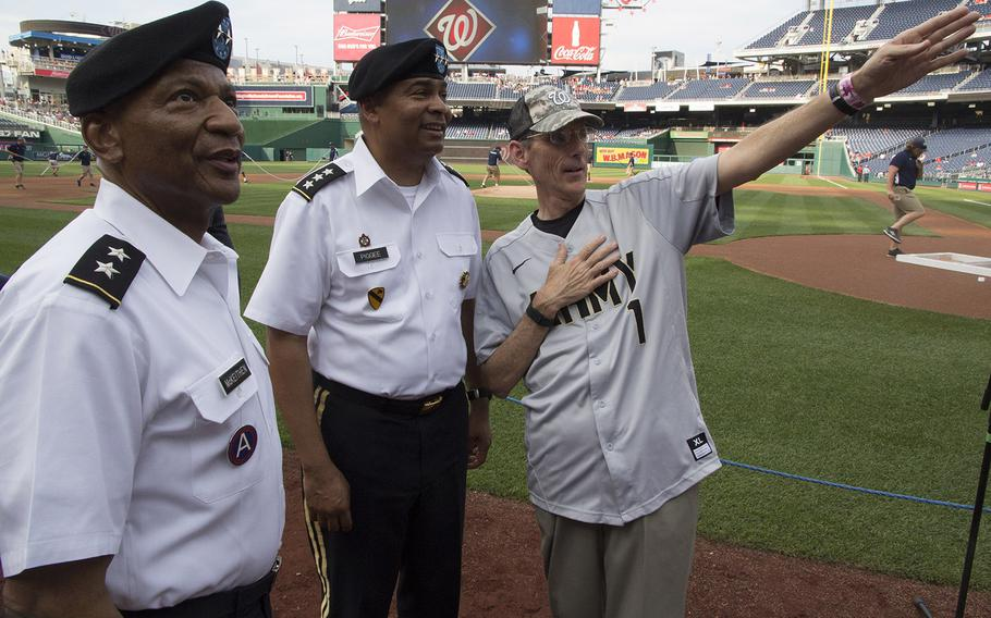 Acting Secretary of the Army Robert M. Speer, right, talks with Maj. Gen. Timothy M. McKeithen, left, Deputy Director of the Army National Guard and Lt. Gen. Aundre F. Piggee, Deputy Chief of Staff, G4 (Army Logistics), on U.S. Army Day at Nationals Park in Washington, D.C., June 12, 2017.