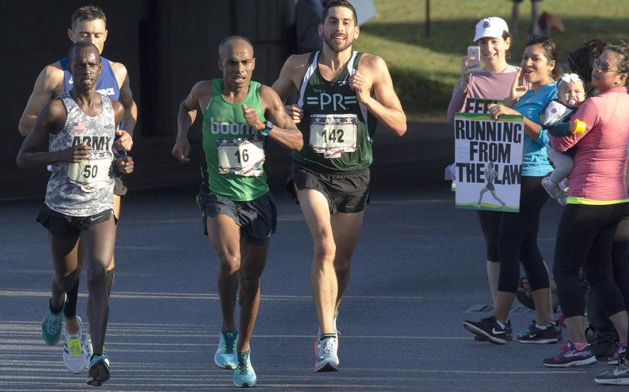 Desta Beriso Morkama (16)  of Arlington, Va., nears the 11-mile mark on his way to a win in the men's division of Sunday's Marine Corps Marathon in Washington, D.C., Oct. 22, 2017. With him are Jeffrey Stein (142) who finished eighth; Michael Biwott (50, sixth) and Kristopher Houghton 71, fourth).