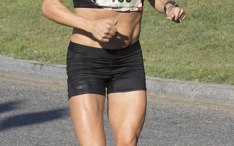 Sarah Bishop of Fairfax, Va., approaches the 17-mile mark on her way to a win in the women's division of the Marine Corps Marathon, Oct. 22, 2017 in Washington, D.C.