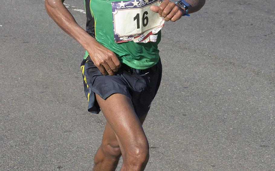 Desta Beriso Morkama of Arlington, Va., approaches the 17-mile mark on his way to a win in the men's division of the Marine Corps Marathon, Oct. 22, 2017 in Washington, D.C.
