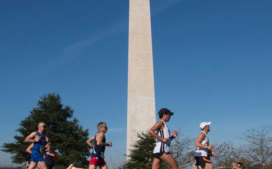 Runners in the Marine Corps Marathon pass the Washington Monument, Oct. 22, 2017.