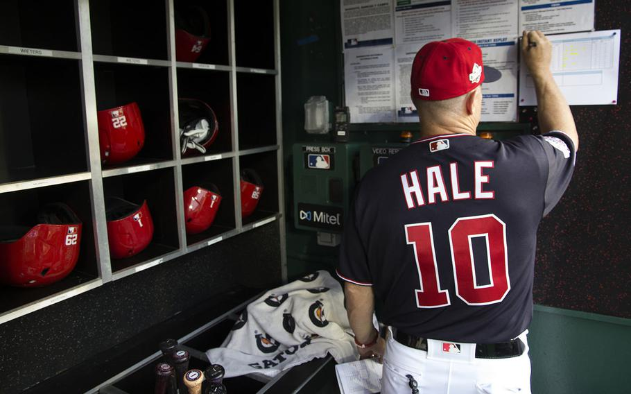 Washington Nationals bench coach Chip Hale works on the lineup card before a game against the San Diego Padres at Nationals Park on May 22, 2018.