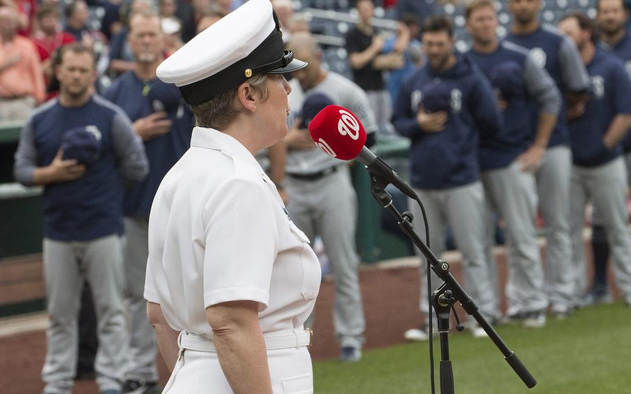 Chief Musician Shana Sullivan of the U.S. Navy Band sings the national anthem as San Diego Padres players and coaches stand on the baseline before a game at Nationals Park in Washington, D.C., May 22, 2018.