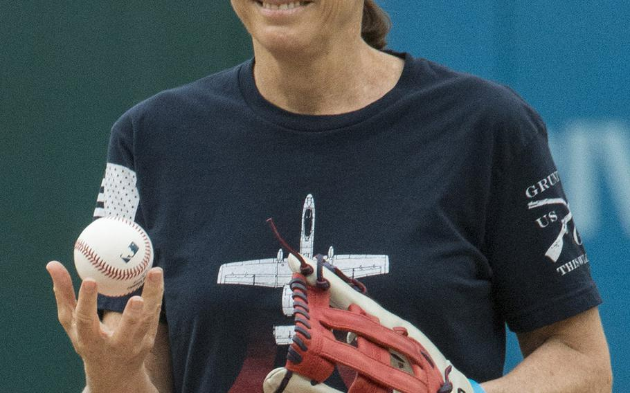 """Sporting a t-shirt depicting an A-10 """"Warthog"""" aircraft like the one she flew as an Air Force pilot, Rep. Martha McSally, R-Ariz., prepares to throw the ceremonial first pitch on Women in the Military Day at Nationals Park in Washington, D.C., May 22, 2018."""