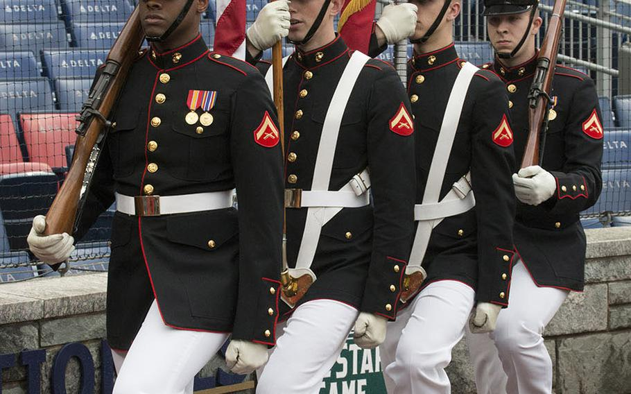A U.S. Marine Corps color guard arrives for a ceremony before a Washington Nationals game on May 22, 2018.