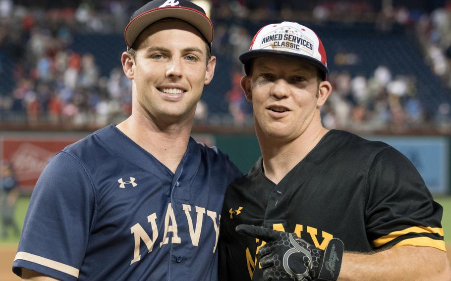 U.S. Navy Petty Officer 3rd Class Russ Newbern and Army's Staff Sgt. Jacob Hensal will get a chance to hit home runs in between big-league batters at Major League Baseball's All-Star home run derby on Monday, July 16, 2018.