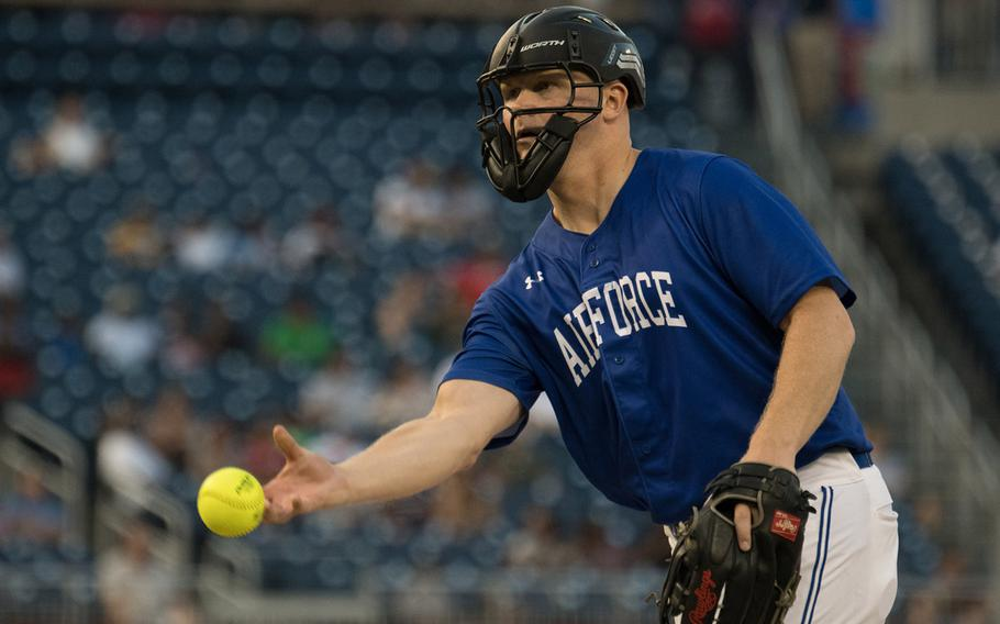 U.S. Air Force Master Sgt. Matthew Campbell pitched and represented his service at a home run derby following the 2018 Armed Forces Classic, a co-ed softball game held at Nationals Park in Washington on Friday, July 13, 2018.