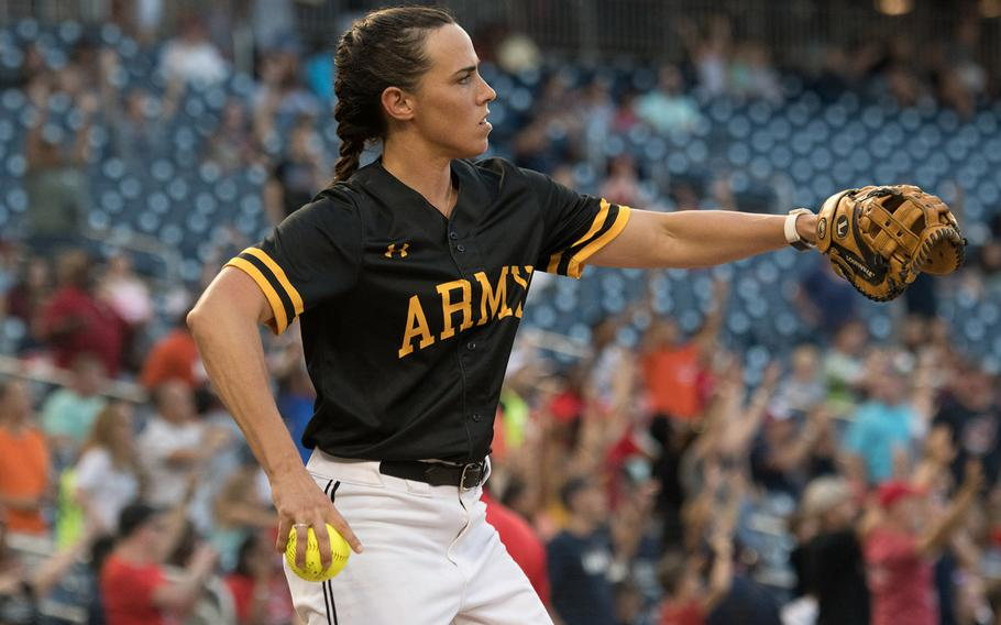 U.S. Army Capt. Kristina Gscheidle warms up in between innings at the 2018 Armed Forces Classic, a co-ed softball game held at Nationals Park in Washington on Friday, July 13, 2018.