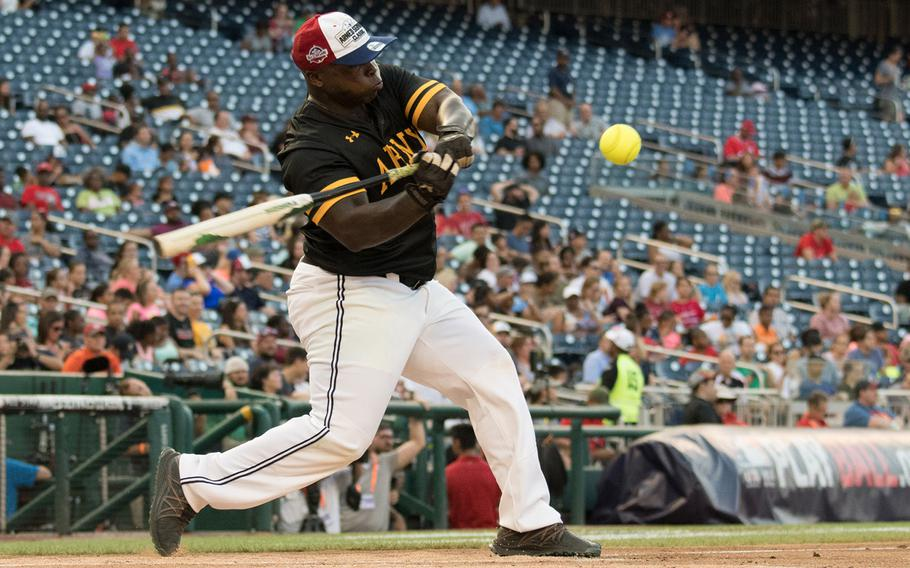 Chief Warrant Officer 3  Richard Moreland swings at a pitch during the 2018 Armed Forces Classic, a co-ed softball game held at Nationals Park in Washington on Friday, July 13, 2018.