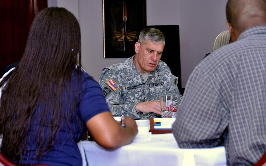 Gen. David M. Rodriguez, U.S. Africa Command commander, responds to questions from a delegation of media representatives from Angola and Mozambique during a briefing at the command headquarters in Stuttgart, Germany.