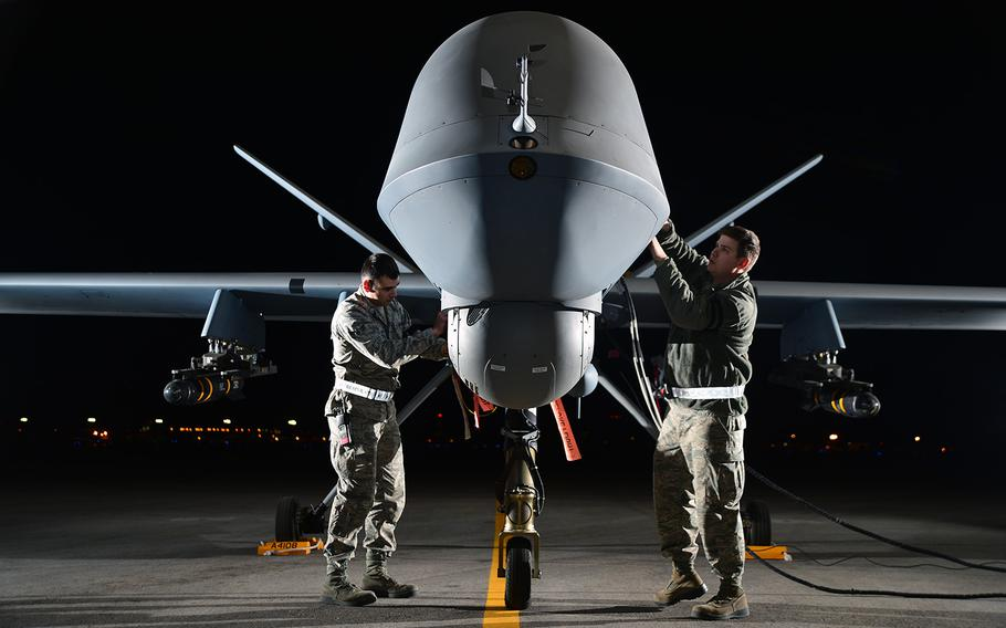 U.S. airmen prepare an MQ-9 Reaper for flight at Creech Air Force Base, Nev., on May 15, 2014.