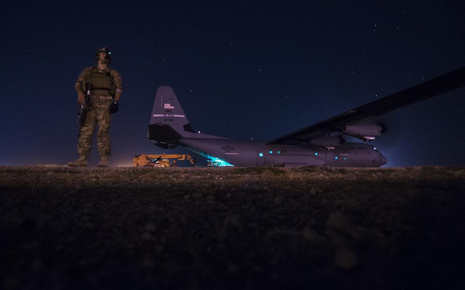 A fly-away security team from the 1st Battalion, 153rd Infantry Regiment provides security for a C-130J, May 26, 2017, during a cargo mission in Somalia, supporting the Combined Joint Task Force-Horn of Africa.
