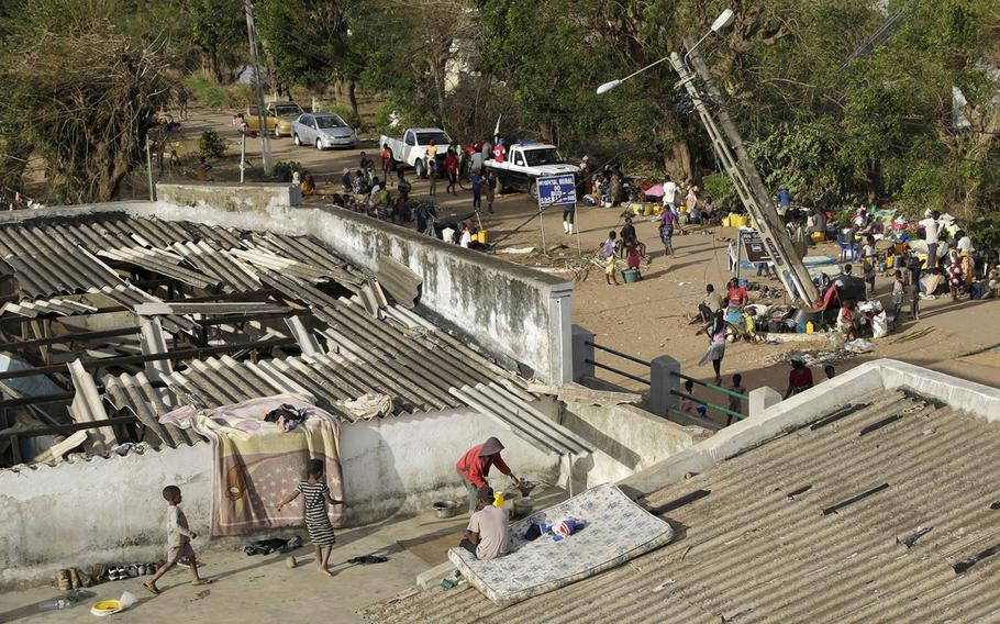 Displaced families set up their bedding on top of the roof in Buzi district, 120 miles outside Beira, Mozambique, on Saturday, March 23, 2019.
