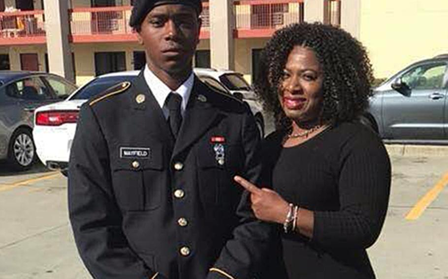 Spc. Henry Mayfield Jr., 23, seen here with his mother Carmoneta Horton-Mayfield, was among three Americans killed in an early morning attack Jan. 5, 2020, in Kenya after their military base was overrun by al-Shabab fighters.