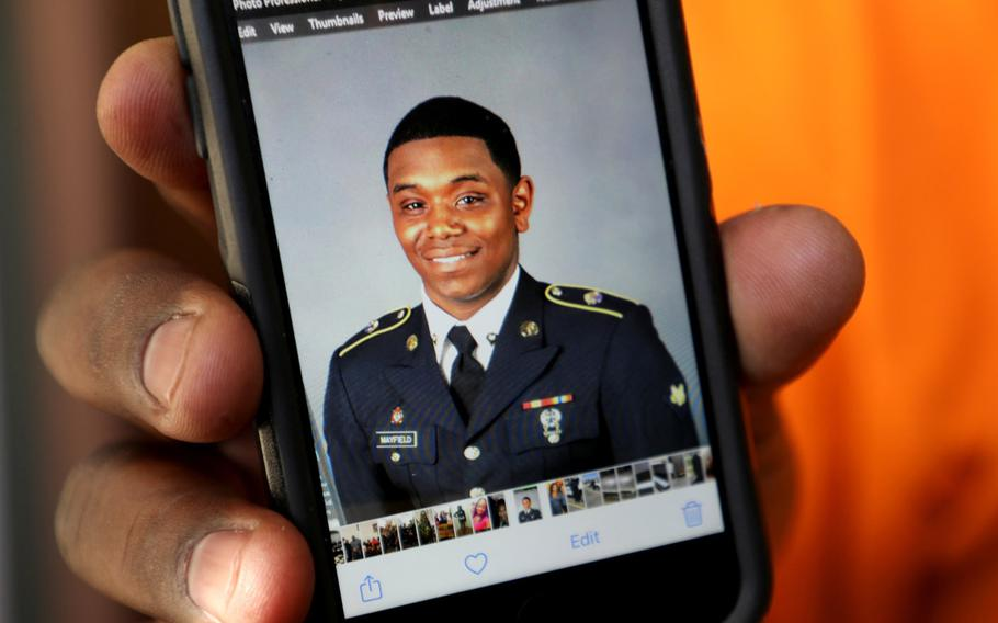 Henry Mayfield holds a picture of his son, Army Spc. Henry Mayfield Jr., who was killed in an attack on a military base in Kenya.
