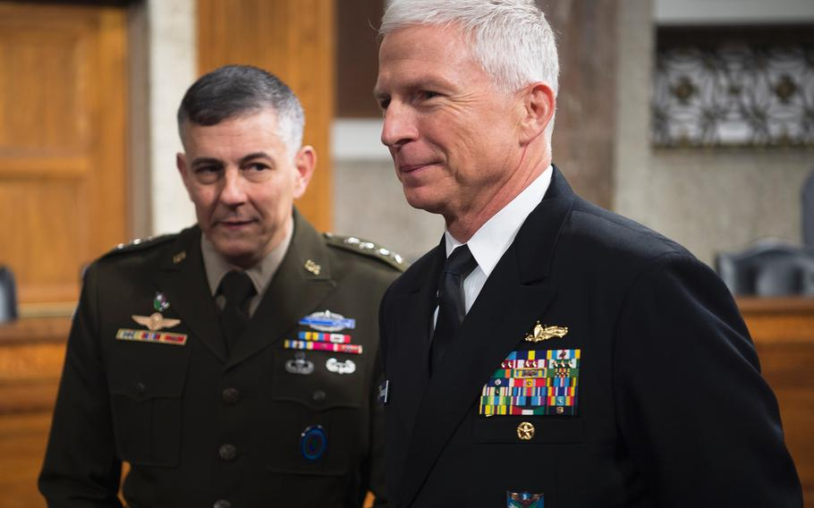 Adm. Craig Faller and Gen. Stephen Townsend, respectively commanders of Southern Command and Africa Command, prepare to testify before the Senate Armed Services Committee on Thursday, Jan. 30, 2020, on Capitol Hill in Washington.