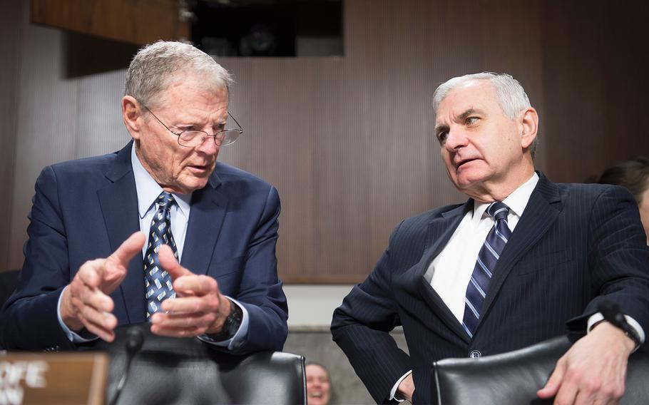 Sen. Jim Inhofe, R-Okla., left, and Sen. Jack Reed, D-R.I., chat prior to the start of a Senate Armed Services Committee hearing Thursday, Jan. 30, 2020, on Capitol Hill in Washington.