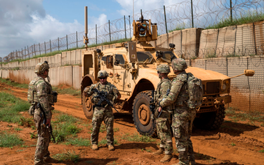 U.S. Army soldiers discuss security operations during a  patrol in Somalia in December 2019. A White House plan to reduce forces in conflict zones includes removing all 700 troops in Somalia, according to media reports.