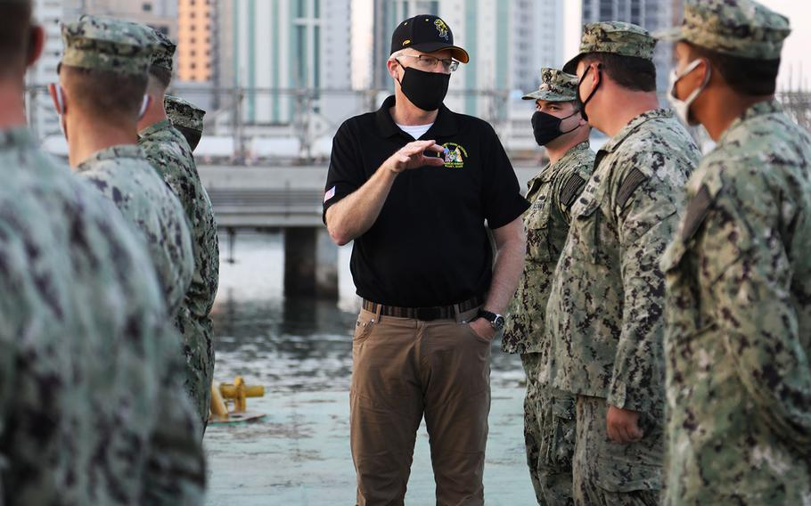 Acting Defense Secretary Christopher Miller speaks with sailors of Commander Task Force 56 on the waterfront at Naval Support Activity Bahrain Nov. 25, 2020. Miller is visiting troops in the Middle East for the Thanksgiving holiday.